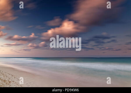 Afterglow with clouds by the sea, Playa Bavaro, Punta Cana, Dominican Republic - Stock Photo