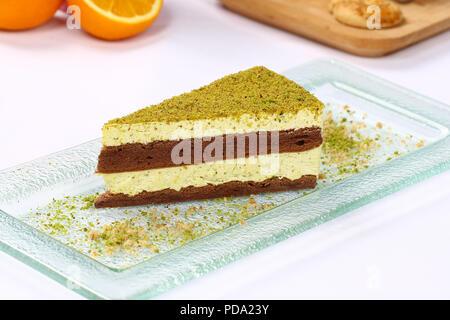Three chocolate layered mousse cake - pistachio cheesecake - Stock Photo