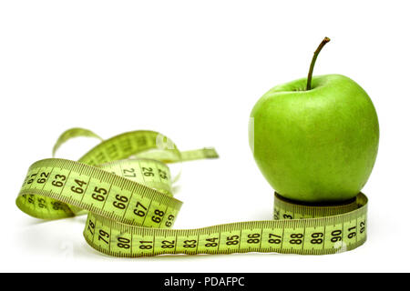 Diet, healthy eating, food and weigh loss concept. Measuring tape and green apple on white background - Stock Photo