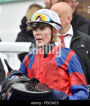 Brighton, UK. 9th Aug, 2018. Jockey Poppy Bridgewater looks pretty muddy after riding Time Medicean at the Brighton Races Marathonbet Summer Festival of Racing Ladies Day meeting today Credit: Simon Dack/Alamy Live News - Stock Photo