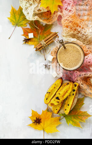 Autumn background baking. Freshly baked raisins and cinnamon biscotti and a cup of cappuccino coffee on light slate or slate background. Top view flat - Stock Photo