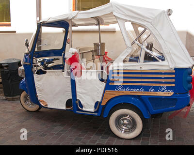 Apecar used for advertising of the restaurant La Pace, old town of Malcesine, Lake Garda, province Verona, Lombardy, Italy - Stock Photo