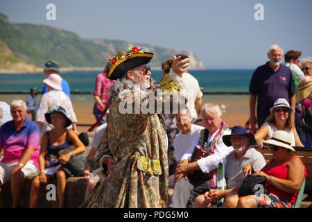 Outdoor Pantomime, Period Costume Fancy Dress Play. Sidmouth Esplanade, at the Summer Folk Festival. East Devon, UK. August, 2018. - Stock Photo