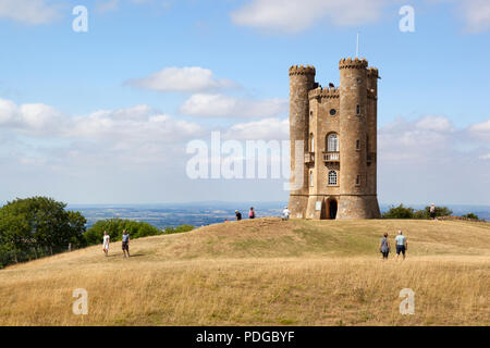 Broadway Tower in summer with tourists in afternoon sunshine - Stock Photo