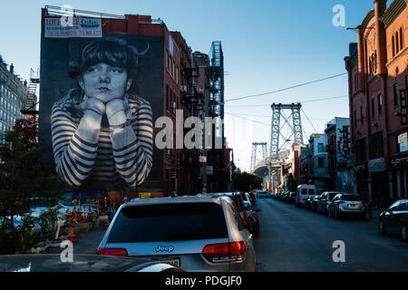 Williamsburg Bridge and Lost Time mural from Brooklyn S 6th Street, New York - Stock Photo