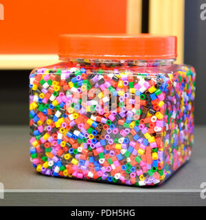 Children's colorful beads for peyote stitch. Big plastic jar. For different crafts. - Stock Photo