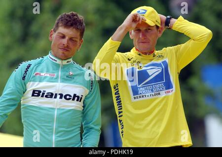 (dpa) - Second placed German Jan Ullrich (L) of Team Bianchi and victorious US Postal-Berry Floor's Lance Armstrong (R) from the US stand side by side on the podium after the 20th stage of the 2003 Tour de France cycling racein Paris, 27 July 2003. Armstrong became the second rider in history to win the Tour de France on five consecutive occasions tying the record of Spain's Miguel Indurain, who won from 1991 to 1995. The 31-year-old American finished the centenary running of the Tour with a lead of 1:01 minutes over German Jan Ullrich, with Alexandre Vinokourov of Kazakhstan in third place, 4 - Stock Photo