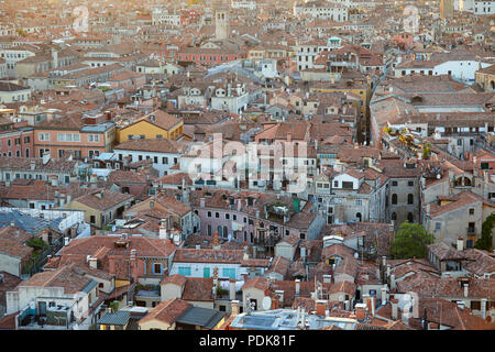 Aerial view of Venice roofs, city and buildings before sunset in Italy - Stock Photo