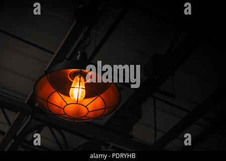 industrial hang light lamp for modern loft style decorating interior with copy space - Stock Photo