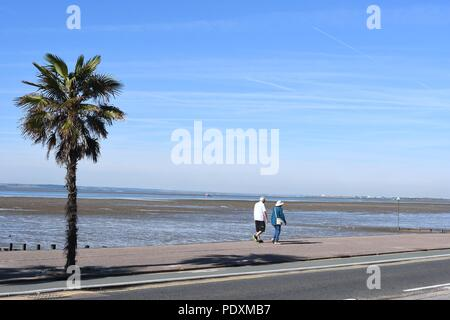 Southend-on-Sea, Essex, UK. 11th August, 2018. UK Weather: A warm start to the day in Southend - a view of people walking along the sea front Credit: Ben Rector/Alamy Live News - Stock Photo