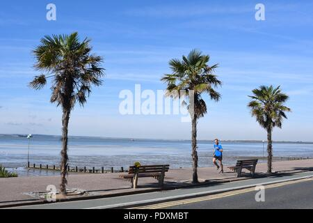Southend-on-Sea, Essex, UK. 11th August, 2018. UK Weather: A warm start to the day in Southend - a view of a Man jogging along the sea front Credit: Ben Rector/Alamy Live News - Stock Photo