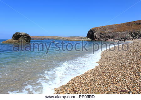 The beautiful rugged Cornish coastline during high tourist season at Polzeath Beach, North Cornwall, Uk. Summer August 2018 - Stock Photo