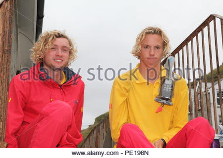 Two RNLI Life Guards pose for the camera at Trebarwith Strand, North Cornwall, UK. Summer August 2018 - Stock Photo