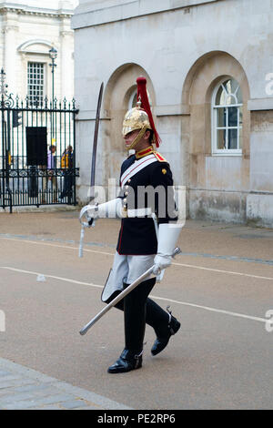 Horse Guards Parade soldier on duty with sword - Stock Photo