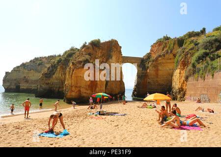 LAGOS, PORTUGAL - JUNE 23, 2018: tourists relaxing on Praia da Batata beach, Lagos, Algarve, Portugal, Europe - Stock Photo