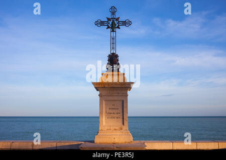 Iron cross on marble plinth with inscription In Memoriam Jubilaei 1829 et Pacis 1871, Nice city seaside, Provence-Alpes-Côte d'Azur, France - Stock Photo