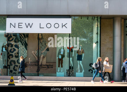 Shoppers walking past frontage of New Look store with mannequins in glass window, Princes Street, Edinburgh, Scotland, UK - Stock Photo
