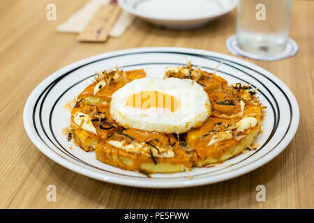 Okonomiyaki, Japanese Pizza on the wooden table. - Stock Photo