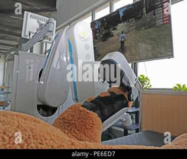 Shenyang. 16th July, 2018. Photo taken on July 16, 2018 shows an assistant robot for rehabilitation at a factory of SIASUN in Shenyang, capital of northeast China's Liaoning Province. In recent years, by developing robots and intelligence industry, Shenyang has become a new engine for economic reform and upgrading in Liaoning. Credit: Yang Qing/Xinhua/Alamy Live News - Stock Photo