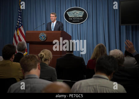 Secretary of Defense Ash Carter speaks with reporters during a press briefing at the Pentagon Oct. 15, 2015, about the U.S. troop posture in Afghanistan. (DoD photo by Senior Master Sgt. Adrian Cadiz)(Released) - Stock Photo