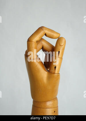 Wooden Hand Manikin making all good zero gestures - Stock Photo