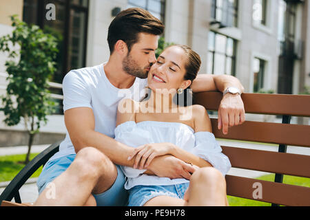 Nice handsome man kissing his wife - Stock Photo