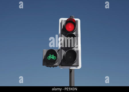 A cycle priority traffic signal. The green light gives cyclists a headstart, allowing them to cross the junction before the rest of the traffic. - Stock Photo