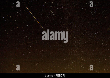 Burlington, Iowa, USA. 13th August, 2018. Two meteors in the annual Perseid shower as seen from the John H. Witte observatory in Des Moines County, Iowa, USA. The meteors appear as streaks, one bright and the other faint in a time lapse photo. Credit: Keith Turrill/Alamy Live News - Stock Photo