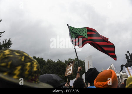 Washington D.C, USA. 12th Aug, 2018. The African American flag is flown at the Unite the Right 2 rally in Washington, DC.Despite predictions of a huge rally by the Alt-Right celebrating the first anniversary of the Unite The Right rally in Charlottesville, Virginia, only 15 showed up to march in Washington, DC on Saturday August 12. The small group was met by over a thousand anti-fascist protesters who marched from the city's Freedom Plaza to meet the handful of white supremacists who gathered under police guard under at a park behind the White House. Police eventually provided - Stock Photo
