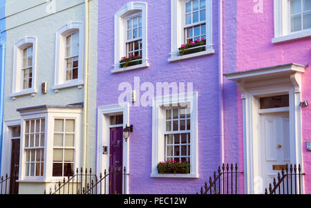 A row of pretty pastel Georgian houses on Bywater Street, off the Kings Road, Chelsea, London SW3, England, UK - Stock Photo