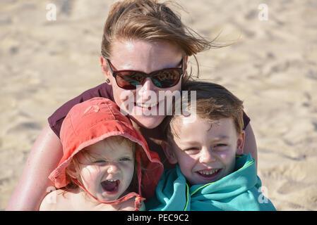 Happy family at the beach, Rambla beach, Montevideo, Uruguay - Stock Photo