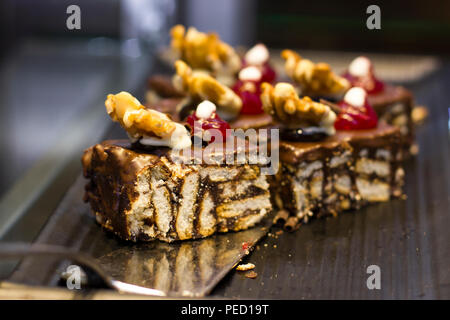 Mosaic chocolate cake with an walnut and berries - Stock Photo