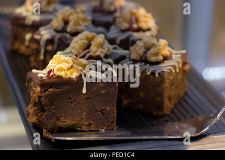 Chocolate cake with an walnut and berries - Stock Photo