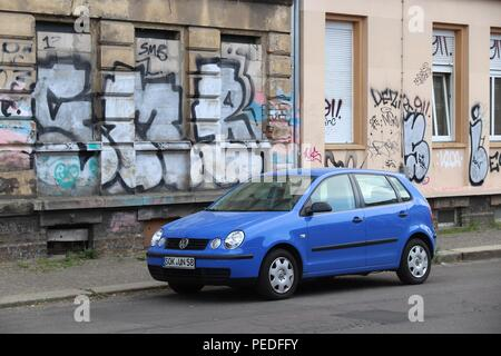 LEIPZIG, GERMANY - MAY 9, 2018: Blue Volkswagen Polo compact hatchback city car parked in Germany. There were 45.8 million cars registered in Germany  - Stock Photo