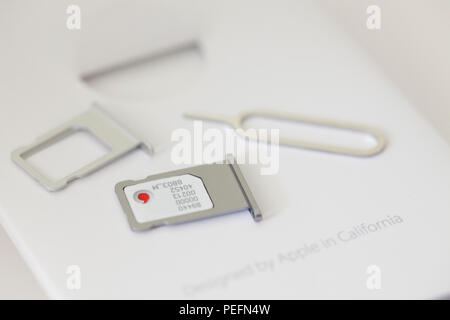 Small parts and sim card for new iPhone - Stock Photo