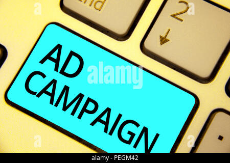 Text sign showing Ad Campaign. Conceptual photo promotion of specific product or service through internet Keyboard blue key Intention create computer  - Stock Photo