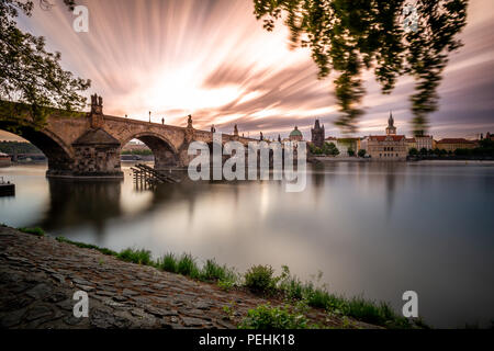 View of Charles Bridge from Kampa with long exposure, Prague - Stock Photo