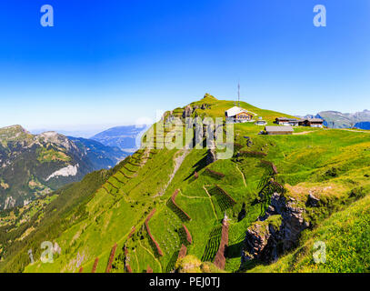 Maennlichen cable car station above Wengen and the Lauterbrunnen Valley, Jungfrau region and path to the Royal View, Bernese Oberland, Switzerland - Stock Photo