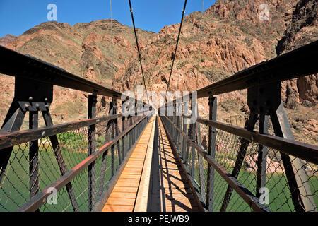 AZ00289-00...ARIZONA - The Black Bridge over the Colorado River on the South Kaibab Trail in Grand Canyon National Park. - Stock Photo