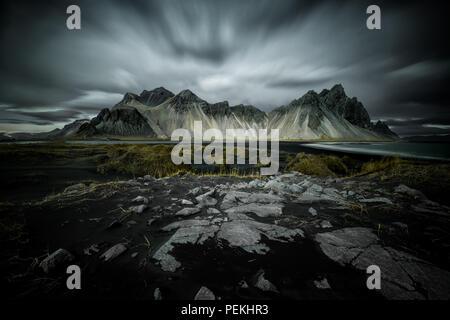 Long Exposure Landscape shot of Vestrahorn mountain range near Hofn, Iceland - Stock Photo