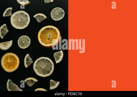 Citrus on a black background. Many slices of lemon, orange, lime lie together. A lot of fruits. Vitamins and a healthy snack. Nearby place for text. - Stock Photo