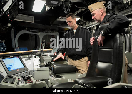 160106-N-AT895-341 PENSACOLA, Fla. (Jan. 6, 2016) Chief of Naval Operations (CNO) Adm. John Richardson tours the littoral combat ship USS Independence (LCS 2). LCS 2 is conducting operational evaluation and testing of the mine countermeasures mission package while berthed at Naval Air Station (NAS) Pensacola. Richardson and Master Chief Petty Officer of the Navy (MCPON) Mike Stevens received an overview of NAS Pensacola's aviation training centers and toured LCS 2. (U.S. Navy photo by Mass Communication Specialist 1st Class Nathan Laird/Released) - Stock Photo