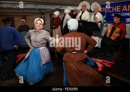Maritime folk concert with singers, musicians and dancers dressed in traditional costume, celebrating the Herring Festival, Boulogne-sur-Mer, France. - Stock Photo