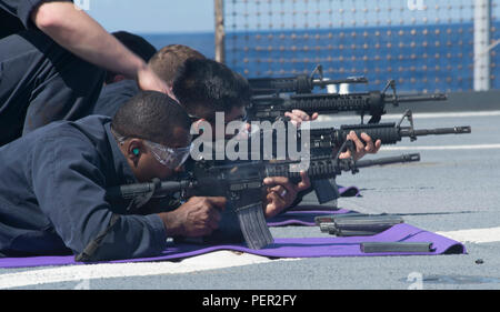 160130-N-RM689-145  SOUTH CHINA SEA (January 30, 2016)- Sailors participate in a M16 live-fire exercise on the flight deck of the forward-deployed amphibious dock landing ship USS Ashland (LSD 48). Ashland is assigned to the Bonhomme Richard Amphibious Ready Group and is enroute to participate in Cobra Gold, a Thai-U.S. co-sponsored multinational joint exercise designed to advance regional security by exercising a robust multinational force from nations sharing common goals and security commitments in the Indo-Asia-Pacific region. (U.S. Navy photo by Mass Communication Specialist Kelsey L. Ada - Stock Photo