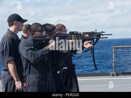 160130-N-RM689-634  SOUTH CHINA SEA (January 30, 2016)- Sailors participate in a M16 live-fire exercise on the flight deck of the forward-deployed amphibious dock landing ship USS Ashland (LSD 48). Ashland is assigned to the Bonhomme Richard Amphibious Ready Group and is enroute to participate in Cobra Gold, a Thai-U.S. co-sponsored multinational joint exercise designed to advance regional security by exercising a robust multinational force from nations sharing common goals and security commitments in the Indo-Asia-Pacific region. (U.S. Navy photo by Mass Communication Specialist Kelsey L. Ada - Stock Photo
