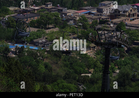 Chinese People Taking Cable Car to Enjoy Beautiful Scenery of Natural Landscape - Stock Photo