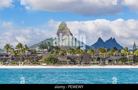 Flic en flac beach with Piton de la Petite Riviere Noire Mauritius. - Stock Photo