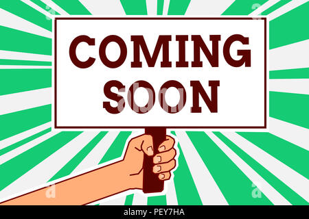 Writing note showing Coming Soon. Business photo showcasing something is going to happen in really short time of period Man hand holding poster import - Stock Photo