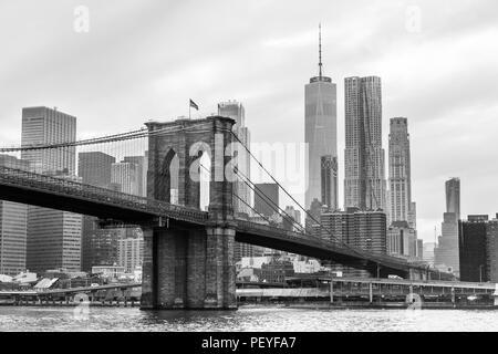 Brooklyn Bridge and Manhattan skyline in black and white, New York, USA. - Stock Photo