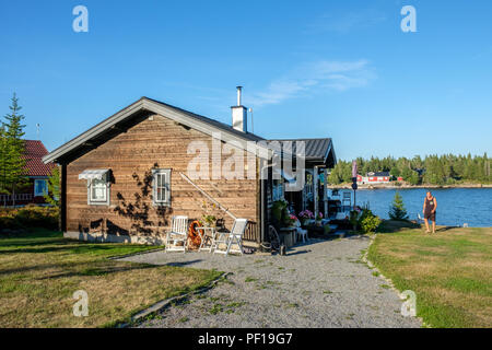 Summer day at Sundsviken outside Lovanger in northern Sweden. This is a popular area for summer cottages in county Vasterbotten. - Stock Photo
